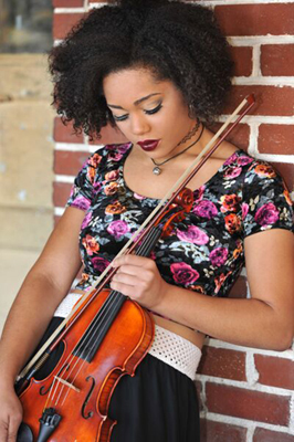 Mikhayla playing a violin